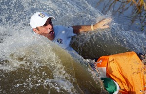 Paul McGinley is thrown into the lake by his teammates after he holed the winning putt to give Europe victory